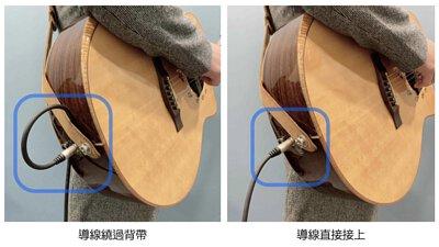 吉他導線繞過背帶