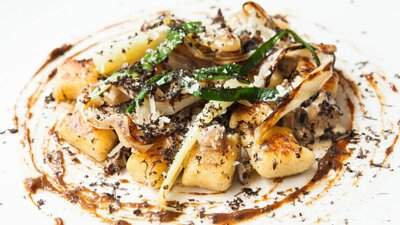 Sautéed potato gnocchi with mushrooms, parmesan and black truffle