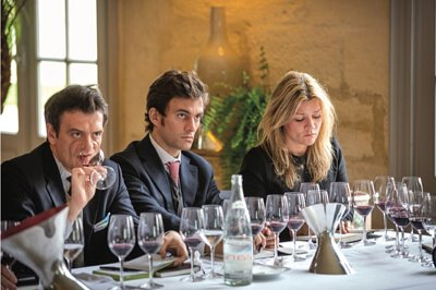 Perluigi Gorgoni (left), the author of this article, as he tastes the vintages of Cheval des Andes